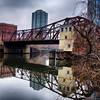 A reflection of the Kinzie Bridge over the Chicago river in downtown Chicago on a gray morning in November.