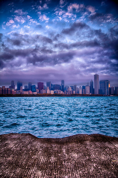 Shot on a very cold November morning as the sun was obscured by the clouds and they sat on the city. The frame really changed as the sun poked through the clouds. Sunrise shots are always different in the city of Chicago. When you are shooting downtown Chicago around Sunrise you have to get there early enough to catch the pre-sunrise light, just like the post sunset light, it can sometimes be the best time to capture the city. Shot 11-3-13 as the sun rose over the city of Chicago, Illinois.