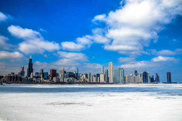 Chicago shot from Solidarity Drive overlooking the skyline. The cityscape of Chicago is magnificent but the white deck of frozen ice over Lake Michigan really makes this shot stand out.