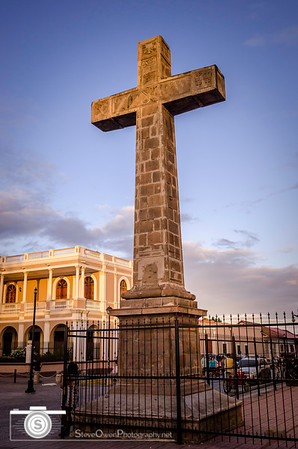 Cross against a violet sky