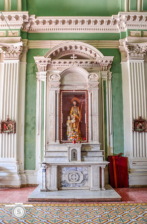 A side alter depicting Jesus in beautiful white marble.