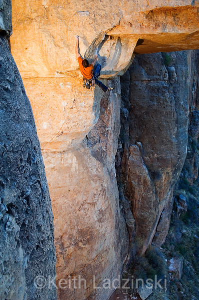 "Brian Rhodes climbing through the crux of ""Head Cheese"" 7c+ Shelf Road Colorado  Contact: Keith Ladzinski web - http://www.ladzinski.com email - keith@ladzinski.com phone - 719.213.6613"