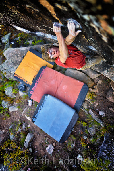 Rock climber William Maodragon bouldering on tiny climbing holds in the San Juan Mountains near Durango Colorado