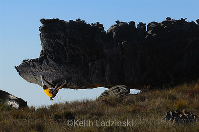"Chuck Fryberger climbing a boulder dubbed ""The Rhino"" in Rocklands South Africa"