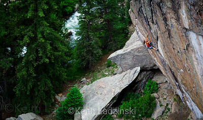 Female rockclimber Lauren Lee climbing a rock face in 11 Mile Canyon, Colorado