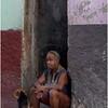 Cuba Havana Centro Havana Man and Dog on Step March 2017