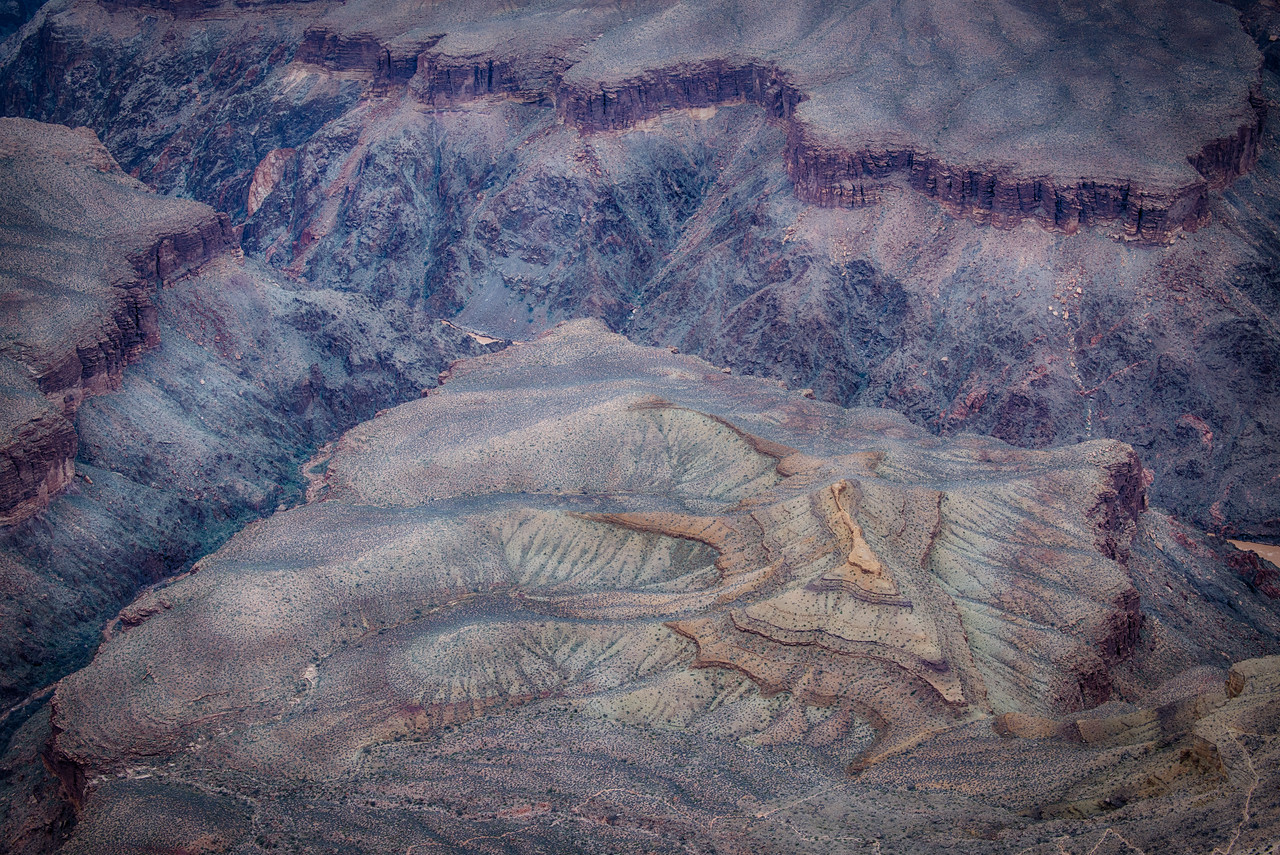 Geology on parade: Bright Angel shale draping the Tonto Plateau formed by the Tapeats Sandstone unconformably resting upon Archaen Vishnu Schist.
