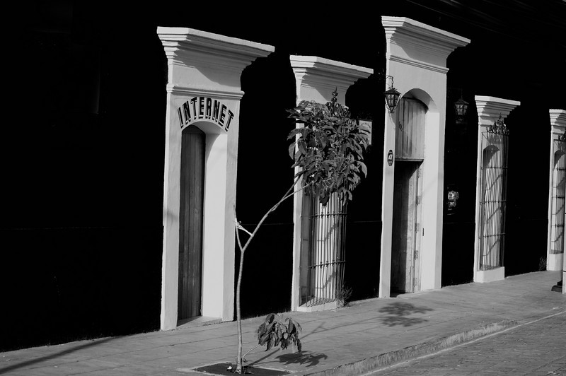 """October 8, 2010 - """"Night And Day""""<br /> <br /> This Oaxaca street image will close out my short b&w series.  It is difficult to not post this beautifully blue building, but I thought the stark contrasts within the b&w version were quite striking and worth a post.  The photo was taken late in the afternoon."""