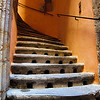 """September 8, 2010 - """"Old Stairs""""<br /> <br /> It was fairly dark in this stairwell but with enough indirect midmorning sunlight for an ISO 3600 shot to pick up the different light created  tones.<br /> <br /> This was shot  in old town in Lyon, France.   The stairway is in a narrow passage way in a dense area of at minimum 4 story high apartments,  The holes in the stairs provide light to the basement area below.<br /> <br /> The architecture in the area is 15th century Gothic.<br /> <br /> The density of the buildings can be seen in my previous post<br /> <br /> <a href=""""http://www.dakotacowboyphotography.com/Daily-Photos/PHOTOGRAPHY-Daily-Photos-2010/10826175_mje4B#983185480_9US4Z"""">http://www.dakotacowboyphotography.com/Daily-Photos/PHOTOGRAPHY-Daily-Photos-2010/10826175_mje4B#983185480_9US4Z</a>"""