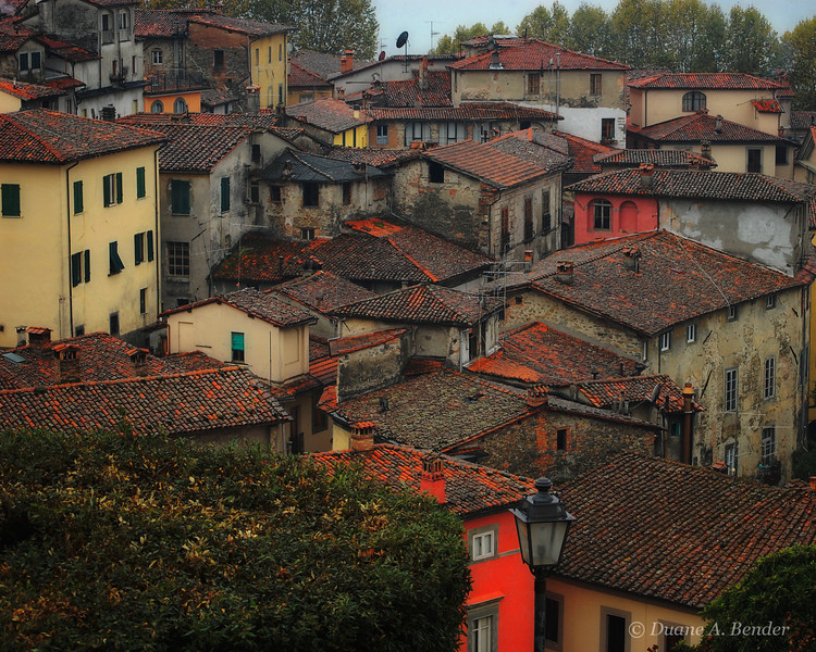 "December 19, 2010 - ""Rain In Barga""<br /> <br /> This is continuation of my series from a few weeks ago that was shot on an October heavy rain day in Italy.  <br /> <br /> ""Barga is a medieval town and comune of the province of Lucca in Tuscany, central Italy. It is home to around 10,000 people and is the chief town of the ""Media Valle"" (mid valley) of the Serchio.<br /> <br /> Founded by the Lombards, the city grew as a castle surrounded by a line of walls, of which two gates (Porta Reale and Porta Macchiaia) have survived. The town was well known during the Middle Ages for the manufacture of silk threads which were exported to major centres such as Florence, its mills powered by the hydraulic power of the nearby creeks. In the Middle Ages, Lucca and Pisa battled frequently to conquer the wealthy town and the surrounding territory, and for a time Barga was part of the Florentine dominion, later Duchy and Grand Duchy of Tuscany. In 1847 it became part of the Duchy of Lucca, maintaining a certain degree of autonomy, until it became part of the Kingdom of Italy in 1861. Between 1331 and 1859 Albiano owed its allegiance to the Florentine State.[citation needed] The region was part of the Gothic Line in World War II, and was the scene of fierce fighting between the Allies and Germans from October 1944 until April 1945.""<br /> <br /> From Wikipedia, the free encyclopedia - December 17, 2010"