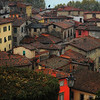 """December 19, 2010 - """"Rain In Barga""""<br /> <br /> This is continuation of my series from a few weeks ago that was shot on an October heavy rain day in Italy.  <br /> <br /> """"Barga is a medieval town and comune of the province of Lucca in Tuscany, central Italy. It is home to around 10,000 people and is the chief town of the """"Media Valle"""" (mid valley) of the Serchio.<br /> <br /> Founded by the Lombards, the city grew as a castle surrounded by a line of walls, of which two gates (Porta Reale and Porta Macchiaia) have survived. The town was well known during the Middle Ages for the manufacture of silk threads which were exported to major centres such as Florence, its mills powered by the hydraulic power of the nearby creeks. In the Middle Ages, Lucca and Pisa battled frequently to conquer the wealthy town and the surrounding territory, and for a time Barga was part of the Florentine dominion, later Duchy and Grand Duchy of Tuscany. In 1847 it became part of the Duchy of Lucca, maintaining a certain degree of autonomy, until it became part of the Kingdom of Italy in 1861. Between 1331 and 1859 Albiano owed its allegiance to the Florentine State.[citation needed] The region was part of the Gothic Line in World War II, and was the scene of fierce fighting between the Allies and Germans from October 1944 until April 1945.""""<br /> <br /> From Wikipedia, the free encyclopedia - December 17, 2010"""