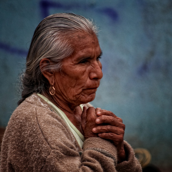 """December 27, 2010 - """"A Poignant Moment""""<br /> <br /> This was photographed at a Sunday Market in Tiacolula, Mexico.<br /> <br /> There is a black and white version of this photo at<br /> <a href=""""http://www.dakotacowboyphotography.com/Photography/DigitalGrin/12008237_2i44E#1137512862_sm8Gd"""">http://www.dakotacowboyphotography.com/Photography/DigitalGrin/12008237_2i44E#1137512862_sm8Gd</a>"""