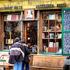 "December 16, 2009 - ""Rare Books""<br /> <br /> I enjoy exploring the detail in this photo (2007).  The store also has a fascinating history.<br /> <br /> From Wikipedia, the free encyclopedia<br /> ""Shakespeare and Company is an independent bookstore located in the 5th arrondissement, in Paris's Left Bank. Shakespeare and Company serves as both a bookstore and a reading library, specializing in English-language literature. The bookstore also houses young writers, known as ""tumbleweeds,"" who earn their keep by working in the shop for a couple of hours each day. The current store is named after and in honour of an earlier store which closed during World War II.   <br /> <br />  The original bookstore's proprietor was Sylvia Beach. It opened in 1919 and was located at 8 rue Dupuytren. In May 1921, Beach moved the store to a larger location at 12 rue de l'Odéon, where it remained until 1941. During this era, the store was considered to be a center of Anglo/American literary culture in Paris. The shop was often visited by artists of the ""Lost Generation,"" such as Ernest Hemingway, Ezra Pound, F. Scott Fitzgerald, Gertrude Stein, George Antheil, Man Ray and James Joyce. The contents of the store were considered high quality and reflected Beach's own literary taste. Shakespeare and Company, as well as its literary denizens, was repeatedly mentioned in Hemingway's A Moveable Feast. Patrons could buy or borrow books like D. H. Lawrence's controversial Lady Chatterley's Lover, which had been banned in England and the United States.<br /> <br /> It was Beach who first published Joyce's book Ulysses in 1922. The book was subsequently banned in the United States and United Kingdom. The original Shakespeare and Company published several other editions of Ulysses under its imprint in later years.<br /> <br /> The Shakespeare and Company store on rue de l'Odeon was closed in December 1941, due to the occupation of France by the Axis powers during World War II. Allegedly, the store was ordered shut because Beach denied a German officer the last copy of Joyce's Finnegans Wake. The store at rue de l'Odéon never re-opened. ................................."""