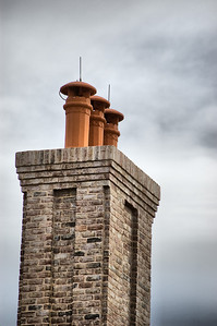 February 12, 2009 - As I look for new daily photo subjects, I thought this chimney might be of interest as it appears to service three different fireplaces and also makes a very simplistic statement.