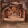 "December 26, 2009 - ""Along The Embrasures""<br /> <br /> My photos of Dry Tortugas National Park were taken 8 years ago with my first digital point and shoot camera.  Thanks to current post processing technology I have been able to enhance these images from photos approximately 400K jpg size.<br /> <br /> Thanks for your suggestions to create some books of some of my post series.  I recently added Grand Teton and Yellowstone National Parks to my published travel oriented books.  You have seen quite a few of the photos in my daily post, but the entire book is available for preview at<br /> <br />  <a href=""http://www.blurb.com/bookstore/detail/975091"">http://www.blurb.com/bookstore/detail/975091</a>   <br /> Covers and links to my other books are at  <br />  <a href=""http://dakotacowboy.smugmug.com/Photography/Published-books/7482816_b2oDK/1/748788471_2k4fU"">http://dakotacowboy.smugmug.com/Photography/Published-books/7482816_b2oDK/1/748788471_2k4fU</a><br /> <br /> From Wikipedia, the free encyclopedia<br /> ""Fort Jefferson's peak military population was 1,729. In addition, a number of officers brought their families, and a limited number of enlisted personnel brought wives who served as laundresses (typically four per company). There were also lighthouse keepers and their families, cooks, a civilian doctor and his family, and others. In all, there were close to 2,000 people at Fort Jefferson during its peak years.  ....................<br /> <br /> The fort remained in Federal hands throughout the Civil War. With the end of hostilities in 1865, the fort's population declined to 1,013, consisting of 486 soldiers or civilians and 527 prisoners. The great majority of prisoners at Fort Jefferson were Army privates whose most common transgression was desertion while most civilian prisoners transgressed by robbery. However, in July 1865 four special civilian prisoners arrived. These were Dr. Samuel Mudd, Edmund Spangler, Samuel Arnold, and Michael O'Laughlen, who had been convicted of conspiracy in the assassination of President Abraham Lincoln. Construction of Fort Jefferson was still under way when Dr. Mudd and his fellow prisoners arrived, and continued throughout the time they were imprisoned there and for several years thereafter, but was never completely finished. Mudd provided much-praised medical care during a yellow fever epidemic at the fort in 1867, and was eventually pardoned by President Andrew Johnson and released. By 1888, the military usefulness of Fort Jefferson had waned, and the cost of maintaining the fort due to the effects of frequent hurricanes and the corrosive and debilitating tropical climate could no longer be justified. In 1888, the Army turned the fort over to the Marine Hospital Service to be operated as a quarantine station."""