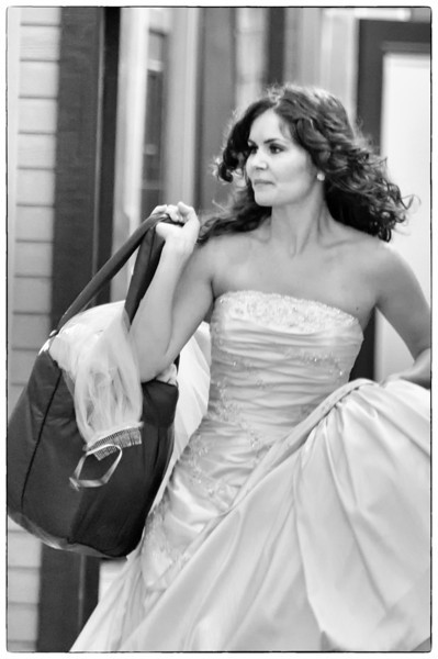 "December 29, 2011 - ""Get Me To The Church On Time""<br /> <br /> This candid was shot much earlier this year when I saw this bride hurrying to a photo shoot."