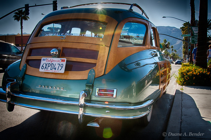 """April 7, 2013 - """"1948 Packard Woody""""<br /> <br /> I had a hard time getting a clear view to shoot  this vintage car  beauty last month.  It was parked here during the 'El Paseo Cruise Night' at Palm Desert, California.<br /> <br /> """"Packard introduced the 22nd Series of Packard Automobiles in 1948. In comparison to the Clipper automobiles, these were wider and available as wagons. The Station Sedan cost $3425 when new and was the most expensive of the short-wheelbase Packards. The substructure was comprised of steel and augmented by wood frames, and panels on the door and upper portions of the body. <br /> <br /> In 1948, Packard produced 3,266 examples of the 22nd Series Station Sedan and 126 in 1947. Production continued until 1949, though a few were sold as 1950 models. Station wagons would not return to the Packard line-up until 1957 and 1958 with the Studebaker-derived wagon.""""<br /> source - <a href=""""http://www.conceptcarz.com/vehicle/z1956/Packard-Standard-Eight.aspx"""">http://www.conceptcarz.com/vehicle/z1956/Packard-Standard-Eight.aspx</a>"""