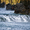 "November 4, 2009 - ""Yellowstone River Revisted""<br /> <br /> Our newly formed local camera club had its first ""critique"" session on Monday evening.  We each submitted 3 images for review that evening.  It was pretty interesting and helpful getting improvement suggestions.  A photo I used was the daily post ""Yellowstone River"".<br /> <br />  <a href=""http://dakotacowboy.smugmug.com/Photography/Daily-Photos-2009/5146058_rXqrj/1/692513312_XwhFT"">http://dakotacowboy.smugmug.com/Photography/Daily-Photos-2009/5146058_rXqrj/1/692513312_XwhFT</a><br /> <br /> One of the most frequent suggestions was to show more of the rocks and the area above the rapids.  Also, maybe cropping out the rock on the left and slower shutter speed to create a smooth water effect. <br /> <br /> This is another shot (not as tight)  that I took at the same location.  Any comments or suggestions on the new scene or/versus the previous post would be appreciated.<br /> <br /> (try looking at X2 or larger per comment from Richard)"