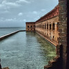 "December 28, 2009 - ""Fort Jefferson Bastions""<br /> <br /> This will conclude the Dry Tortugas National Park series with this photo.  I unfortunately do not have pictures of the beautiful fish that reside in the clear water of the moats.  The daily photos and few more can be viewed in my gallery at<br /> <br />  <a href=""http://dakotacowboy.smugmug.com/Travel/Florida/Dry-Tortugas-National-Park/4307507_xhHP4/1/750153303_7WCfo"">http://dakotacowboy.smugmug.com/Travel/Florida/Dry-Tortugas-National-Park/4307507_xhHP4/1/750153303_7WCfo</a><br /> <br /> From Wikipedia, the free encyclopedia<br /> ""During the Federal government shutdown of 1995, Dry Tortugas was closed along with all other national parks. Seeing this as having a damaging effect on their tourism-dependent economy, the residents Key West, Florida, raised money to keep Dry Tortugas open. The effort was inspired by the Smithsonian Institution, which raised private donations to keep its museums open during the shutdown.<br /> Failing to find anybody to accept the money to reopen the park, Key West residents, under the auspices of the satirical micronation Conch Republic, sent a flotilla of civilian boats and fire department boats to Fort Jefferson in order to reopen the national park. When officials attempted to enter the fort, they were cited. The citation was contested in court the following year, and the resultant case, The United States of America v. Peter Anderson, was quickly dropped.""<br /> <br /> ""A bastion is a structure projecting outward from the main enclosure of a fortification, situated in both corners of a straight wall (termed curtain), facilitating active defense against assaulting troops. It allows the defenders of the fort to cover adjacent bastions and curtains with defensive fire.<br /> The bastion was designed to offer a full range on which to attack oncoming troops. Previous fortifications were of little use within a certain range. The bastion solved this problem. By using a cannon to cover the curtain side of the wall, the forward cannon could concentrate on oncoming targets."""