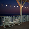 "November 15, 2009 - ""Dusk At Murdochs Breezeway""<br /> <br /> Murdochs on the Galveston Island was destroyed by Hurricane Ike.  The buildings have been completely rebuilt.  The structure consists of a large souvenir shop and a restaurant.  The souvenir side just recently opened and I could still smell the fresh paint.<br /> <br /> Excerpts From<br /> <br />  <a href=""http://www.galveston.com/murdochsbathhouse/"">http://www.galveston.com/murdochsbathhouse/</a><br /> Murdoch's Bathhouse is one of Galveston's most historic locations. Originally built in the late 1800's, the wood structure was constructed directly on the sand. Without the protection of a Seawall , the 1900 storm destroyed the bathhouse. Although the structure was rebuilt in 1901, the storms of 1909 and 1915 were so violent, that reconstruction was required after each.  <br /> ..........In 1910, Mr. William J. Guyette Sr. opened Guyette Gift Shop inside Murdoch's. He knew that with so many visitors coming to Galveston Island, a shop that offered these visitors souvenirs, shells and trinkets, would be a great idea.<br /> .........In 2005, the family connected the existing piers with a breezeway and porch overlooking the Gulf of Mexico. Since the State of Texas, will not allow anymore piers to be built, it stands on some of the original piling that once held Murdoch's Bathhouse.<br /> ........In 2008, Hurricane Ike destroyed Murdochs, and in 2009, miraculously, a brand new, sparkling Murdochs returned in its place."