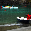 """December 23, 2010 - """"Bailing Time""""<br /> <br /> This is another image in my rainy day in Italy series that I am processing.  In this photo, the boatman is preparing to go bail water from the other boats."""
