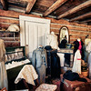 """December 29, 2010 - """"The Latest Fashion Statement""""<br /> <br /> A clothing line is presented in a log cabin museum building in Frisco, Colorado."""