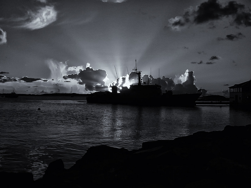 "December 31, 2010 - ""Days End""<br /> <br /> I thought a sunset photo would be appropriate for closing out the year and my 2010 Daily Photo Gallery.  This  image with a French Navy Vessel was shot in the harbor at Marigot, St. Martin in 2002.  The image was generated from a 354kb photo shot with my first digital camera.<br /> <br /> Happy New Year!"
