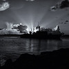 """December 31, 2010 - """"Days End""""<br /> <br /> I thought a sunset photo would be appropriate for closing out the year and my 2010 Daily Photo Gallery.  This  image with a French Navy Vessel was shot in the harbor at Marigot, St. Martin in 2002.  The image was generated from a 354kb photo shot with my first digital camera.<br /> <br /> Happy New Year!"""