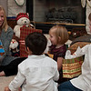 """December 25, 2010 - """"The Night Before Christmas""""<br /> <br /> Our daughter reads to the our grandkids on Christmas Eve, while the children wait """"patiently"""" for dinner and the opening of presents."""
