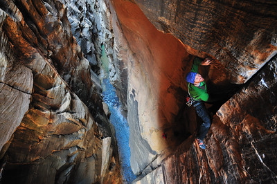"A climber isolated among the iconic walls of ""The Narrows"" in Zion National Park Utah"