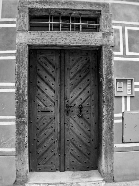 I doubt those police battering rams you see on TV would make a dint in the beautifully detailed timber door.