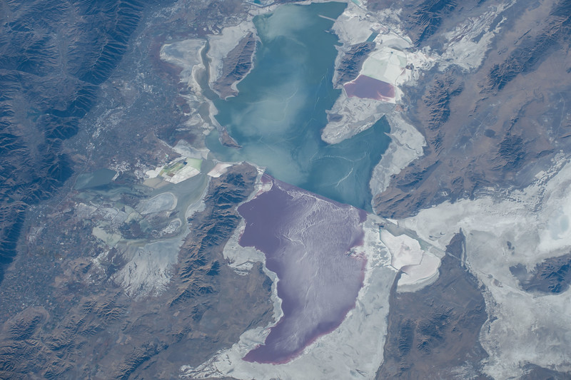 Endorheic lake, largest salt lake in the Western Hemisphere, remnant of a much larger prehistoric lake, habitat to millions of birds, split by a railway causeway. ISS over North America. (ANSWER: Great Salt Lake, Utah, US)