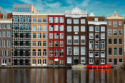 Buildings On The Damrak Canal