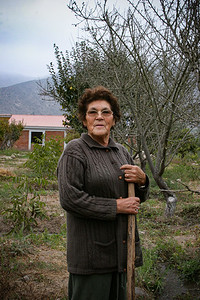 Señora Flora, at 74 years old, was hired to irrigate the trees and grapes at Don Jorge's property in the Valle Elqui, Chile.
