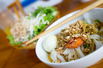 A bowl of Noodle with Pork, Shrimp, vegetables, and Egg