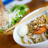 A bowl of Noodle with Pork, Shrimp, vegetables, and Egg (My Tom Thit Trung)