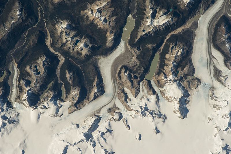 Caption by Space Station Academy student: The image taken contains mountains and glaciers in Patagonia in the South American country Argentina. The photo also has some snow. This shows the temperatures of this region are not warm. This photograph is important beause iy shows the effects of global warming. If they take another picture of Patagonia years later, they can tell if snow melted or not. This helps scientists learn an study the effects of global warming and ways to prevent it.