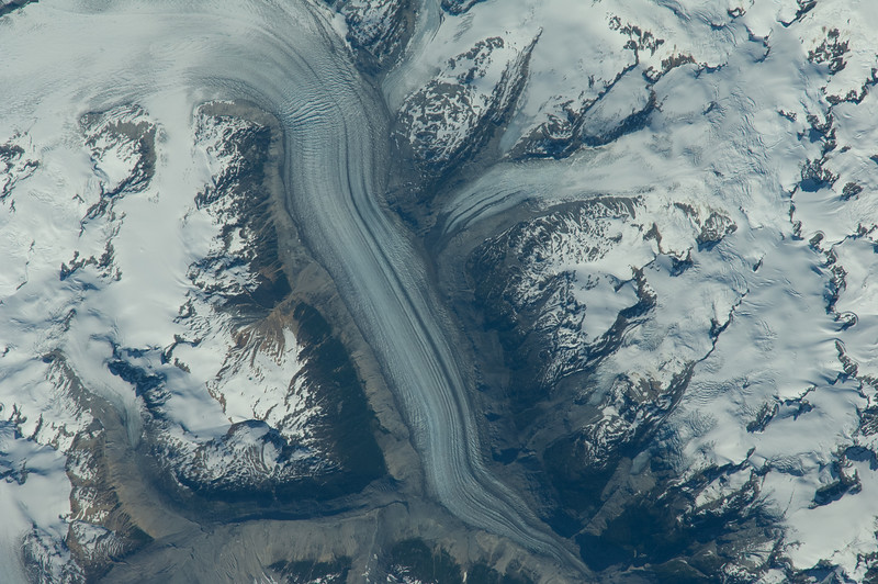 Caption by Space Station Academy student: Snow-capped mountain peaks and glacial ice flow.  Climate change can be monitored by repeatedly imaging changes in glaciers and mountain snow cover.