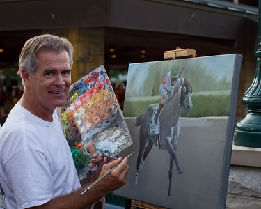 Artist Robert Clark works on a painting of Informed Decision on the rear patio 9.10.2012