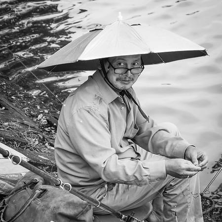 Umbrella hat.  Fisherman, #hanoi #vietnam #xt1 #streetphotography @fujifilm.images