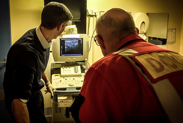 Looking through some medical shots for some work we're doing to highlight the range of practice in rural GP/medicine.  Here's one from last year sometime (care has been taken to ensure no patient identifiable information is visible).  Dr Greg Hamill, GP on Arran, and Dr Stephen Hearns, Consultant with the Emergency Medical Retrieval Service, work together to use ultrasound to gain vascular access in an unwell patient.  (The ultrasound machine was purchased several years ago by kind donation of ARCAS, a local charity).