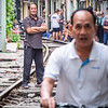 In this shot, I'm intrigued by the juxtaposition between the authoritarian pose of the chap on the tracks, (and his less authoritarian facial expression) versus the slightly mischievous look of the cyclist.  It's as if they know each other.  Meanwhile at this point there was building anticipation of the approaching train (requiring everyone to keep clear of the tracks as it squeezed through).  Apparently last week there was an accident when someone was trapped under the wheels of the approaching train, and locals seemed to show genuine care to ensure that visiting tourists kept safe, but the chap on the bike looks like he knows what he's doing.