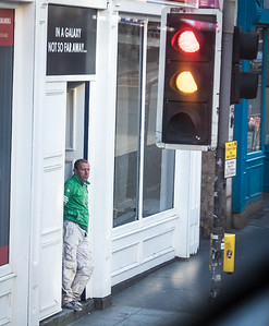 Something about the fact that green is 'missing' from the lights, but provided by this chap's top.  Edinburgh, August 2017