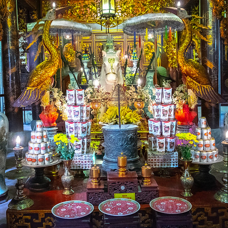 We popped into a number of temples - quiet sanctuaries just a few footsteps off the busy  and vibrant streets of Hanoi.  Various offerings to the gods were on show.  Here's one where the offerings consist of beer and chocolate... some folk have the right idea!