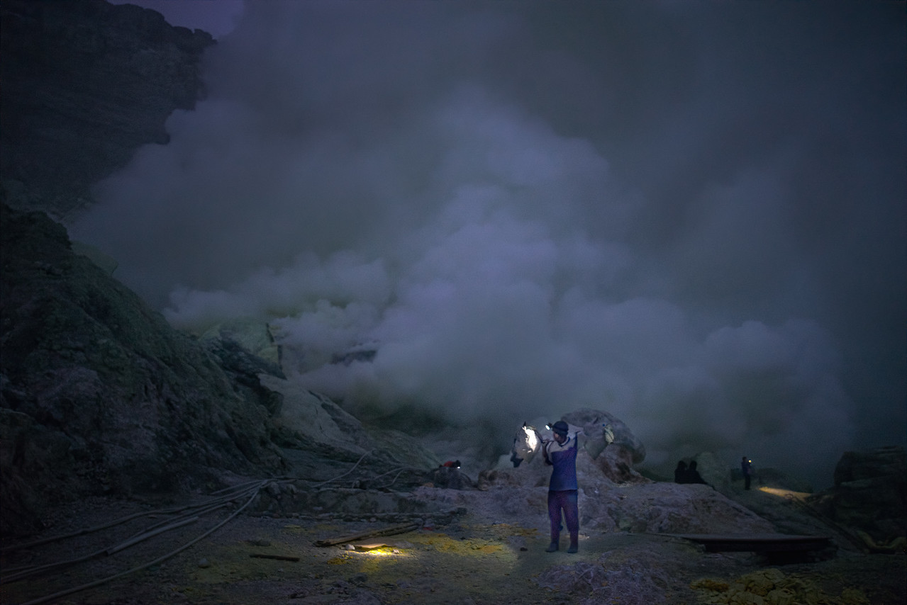 A few hardy souls make their living mining sulphur from the vents in the volcanic crater of Mount Ijen in east Java Indonesia #intentionallylost
