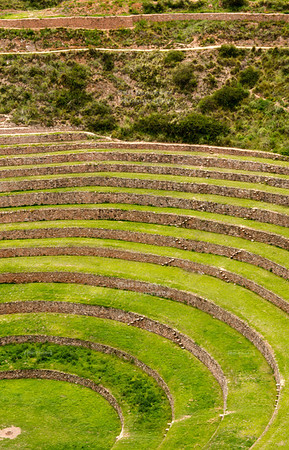 The circular terraces could have been an agricultural experimental station of the Incas. Each level has its own micro climate, where wind and sun create a temperature difference of 15°C (27 °F) between the top and the bottom level