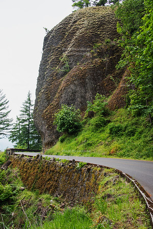 The Historic Columbia River Highway near Shepperds Dell in Multnomah County, Oregon, caved into the steep cliffs of the Columbia River Gorge