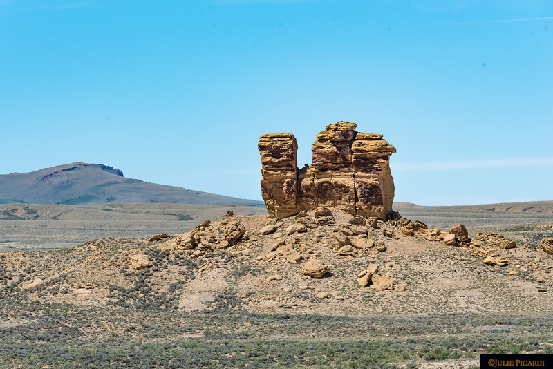 A passing car stopped to inquire if we had car trouble on this desolate road. Living in the area, the kind gentleman told us the name of this rock formation is the Kissing Camels.