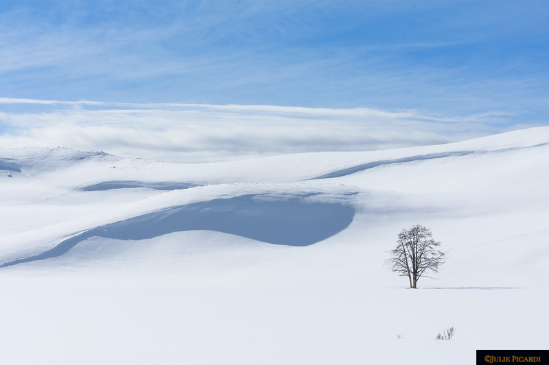 Layers of cloud fold into virgin snow.