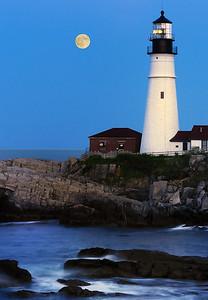 Portland Head lighthouse and full moon; Cape Elizabeth, Maine